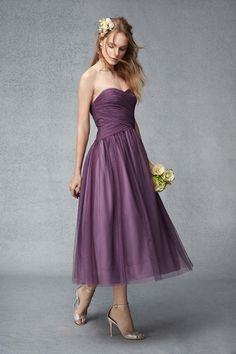Plum ballet length strapless multi-tone tulle dress with draped bodice and full ballerina skirt. Please schedule your appointment for bridesmaids dresses at J.J. Kelly Bridal. www.idoappointments.com