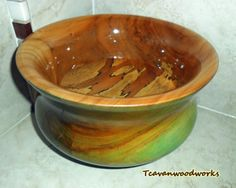 Spalted pecan wood bowl dyed green. Inside center of bowl was not dyed to showcase its natural beauty in contrast with dyed outside parts of the bowl. Beautiful wood grain and unique map-like spalt patterns. I wanted something different this time, so no resin was used in the cracks just turned and dyed for a more natural look! Bowl measures 5 inches tall, 8 and 1/2 inches wide , inside turned depth 3 and 3/4 inches, and about 26 inches circumference. Sanded smooth and finished in se...