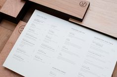 Wooden menu with heat stamp treatment for specialist beef restaurant Fat Cow designed by Foreign Policy