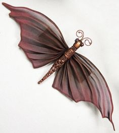 Oriental Moth by Sarah Cavender. Oriental moth with large pleated mesh wings, filigree body and 4mm stone eyes; 3.75