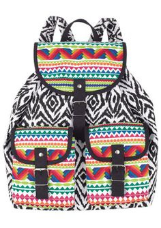this pattern is a little spazzy, but i'm not sure i can express how badly i want a canvas rucksack.