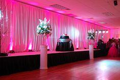 Pink Uplighting on Pipe & Drape Backdrop   Rent online for $19/each + free shipping both ways nationwide at www.RentMyWedding.com/Rent-Uplighting