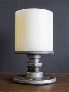 Small industrial pipe candle holder. A handsome base for candlelight, Can accommodates up to 3 in. diameter pillar candles. Hand made
