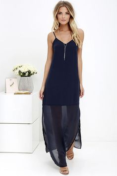 Roses, lilies, and lilacs cannot compare to the beauty of the Gentle Fawn Fleur Navy Blue Maxi Dress! A relaxed-fit, woven triangle bodice (supported by adjustable spaghetti straps) transitions to panels of sheer chiffon that extend down to a maxi-length. Side slits add a flirty finish to this sultry dress. Hidden side zipper.