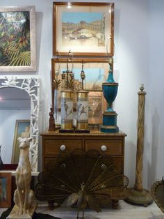antiques and vintage - brass peacock fireplace fan, fornasetti style lamps and 19th century hand colored photos of venice...