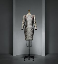 Yves Saint Laurent (French, 1936–2008). Dress, spring/summer 1983, Haute Couture. Machine–sewn, hand–finished black silk crepe; hand–embroidered by Lesage with silver, gray, blue, brown, opalescent, and black gelatin sequins and beads in an imbrication pattern. Photo © Nicholas Alan Cope. #ManusxMachina #CostumeInstitute