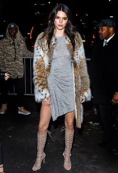 Kendall Jenner draped herself in fur for the launch of Kendall + Kylie clothing at New York Fashion Week on Monday, Feb. 8. See her luxe outfit here!