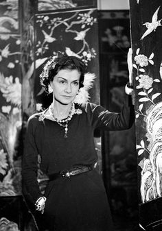 CHANEL~  Coco Chanel  in front of her Coramandel screen in her apartment in the Ritz Hotel, Place Vendôme, Paris  1937