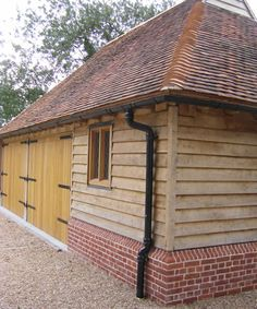 bungalow with brick plinth detail - Yahoo Image Search results Oak Cladding, Wooden Cladding, House Cladding, Oak Framed Buildings, Timber Buildings, Garden Buildings, Timber Frame Garage, Border Oak, Best Garage Doors