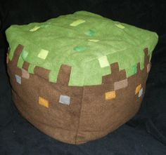 """Character"": Grass Block  Source: Minecraft  Item: Plushie (about 12"" square)  Made by: Em  Date: 2011 (Tekkoshocon)  Notes: On the other end of the spectrum, we have the grass block, with fleece pixellations. Still cuddly, and in this form, equally unlikely to explode. ---- HEY HEY!!!  For more COOL MINECRAFT stuff, check out http://minecraftfamily.com"
