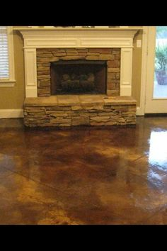 Tan and Black acid stained concrete floor.