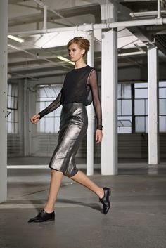 "(""#NYFW Black sheer long sleeve blouse and silver metallic leather skirt outfit. BLK DNM, Ready-to-Wear Spring 2014. Photo: Courtesy of BLK DNM"")"
