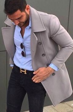 Blue button up with black belt and gray-brown pea coat