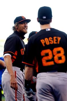 KANSAS CITY, MO - OCTOBER 21: Hunter Pence #8 and Buster Posey #28 of the San Francisco Giants talk prior to Game One of the 2014 World Series at Kauffman Stadium on October 21, 2014 in Kansas City, Missouri. (Photo by Ed Zurga/Getty Images)