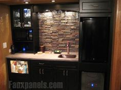 The dry stack stone backsplash brings contrast to this perfectly designed kitchenette.