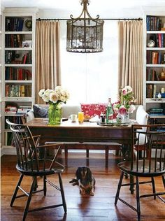 I like this idea for my dining room window, shelving on each side and a settee for one side of my dining table against the window for a reading nook when not eating!
