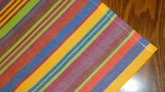 Handwoven Napkins set 4  Fair Trade Handloomed by EducationAndMore, $18.00 For the casual look this tablecloth and napkins set is great for that next fiesta themed, south of the border party. Lively multi colors were woven to make this set: red, blue, yellow, lime green, orange, muted magenta and more.
