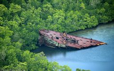 The debris of a United States Naval transport vessel remains abondoned in Nggela Islands, Solomon Islands Islands In The Pacific, Pacific Ocean, Navy Corpsman, Imperial Japanese Navy, Island Pictures, Ww2 History, Aerial Images, Us Marine Corps, Solomon Islands