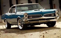 "PONTIAC GTO: circa 1967; a rare blue ""GOAT"" with a black convert able with a 400 4bbl engine and a ""HURST dual gate"" automatic shifter!"