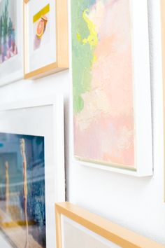 Pastel colored artwork on gallery wall