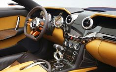 Giugiaro Ford Mustang. Interior design [Wow, that looks so much better. The gear shift is kinda funky, but that's cool. ~sdh]