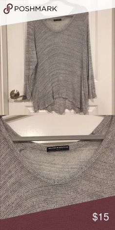 "Brandy Melville-Distressed grey sweater Worn once. Does have pulls and loose strings but it came that way, it's a ""worn"" look. Very light knit sweater. Brandy Melville Sweaters V-Necks"