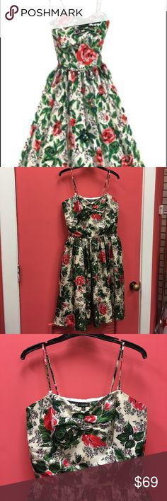 J Peterman Summer Rose Garden Dress Beautiful summer dress, 100% silk, fully lined. All J Peterman dresses are special and you never seem to go out of style. Excellent used condition. Dress measures 40 inches in total length. Waist measures approximately 14 inches. Missing one plastic hook on the back left strap (please see photos and ask any questions) all postings in this closet are settled to benefit a women's resource center in Florida. J Peterman Dresses Midi