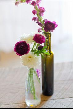 flowers in glass jars http://www.weddingchicks.com/2013/12/05/sweet-and-simple-outdoor-wedding/