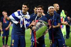 Lionel Messi celebrates with Luis Suarez and Neymar after their 2015 Champions League win