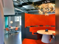 In bright orange, a rounded pod acts as a mini-auditorium