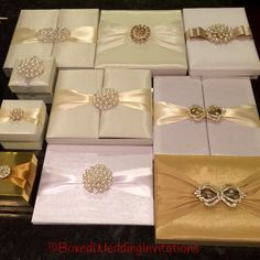 Beautiful wedding invitation boxes in white, Ivory and gold adorned with exquisite embellishments #wedding #invitation #ido #invitationbox  See more at www.boxedweddinginvitations.com