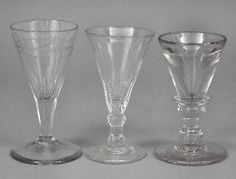"""An 18th Century """"Deceptive"""" glass with conical shaped bowl, double knopped stem and plain footrim, 4ins high (wear to rim), and two late 18th Century ale glasses of trumpet shape"""