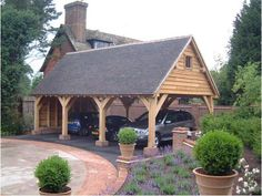 A nice 3-car carport with a high end cabin feeling // Sussex Oak Framers