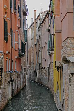 A narrow canal in the backstreets of Venice.