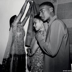 Sidis-people originally from African who have lived in Gujarat for generations.  Note the mehndi.