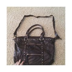 Dark brown cross body bag  Great condition. Second pic shows only flaw. (Tiny scratch) adjustable cross body strap. Offers welcome no brand Bags Crossbody Bags