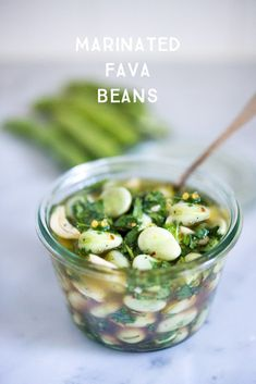 Simple Marinated Fava beans- with olive oil, vinegar, garlic, lemon zest and fresh herbs- a delicious way to preserve summer shelling beans. Serve on your next Mezze Platter ! | #fava #favabeans #freshfava www.feastingathome.com