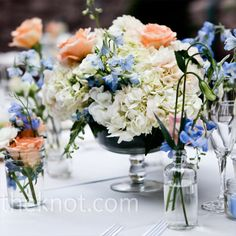 From the Knot  http://theknot.ninemsn.com.au/wedding-planning/real-weddings/summer/jennifer-richard-a-romantic-outdoor-wedding-in-minneapolis-mn/attachment/jenn-richards-outdoor-wedding-white-blue-peach-centrepieces?gallery_id=127980