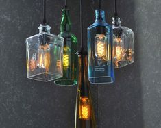 Rustic Colored Glass Bottle Round Chandelier by Moonshine Lamp Co. This is a 6 pendant chandelier made from recycled bottles and wood. It is fully custom made to your liking. Order yours today! Recycled Bottles, Recycled Glass, Recycled Light Bulbs, Diy Luminaire, Colored Glass Bottles, Glass Jars, Recycling, Vintage Industrial Lighting, Vintage Diy
