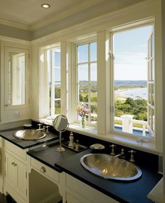 It seems odd to not have a mirror above a bathroom sink but why would you with windows and a view like this?!