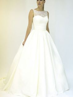 Full ballgown wedding dress with lace illusion neckline
