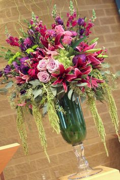 Example of flowers for the church.  This is from a past wedding I did.  A few lavender roses in there and some purple.....:) Marie McKenna Design.