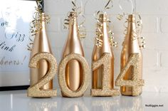 This is a great idea for New Year's Eve decorating. Paint empty wine bottles and wooden numbers with gold spray paint. Cover the numbers in gold glitter and glue to the bottles. Finish by gluing curling ribbon to the top inside of each bottle. Change colors and numbers and use for weddings, anniversaries, graduations or birthdays.