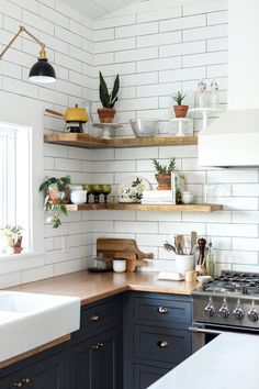 styled open shelving in the kitchen of this Vintage Eclectic Barn   room of the week coco kelley