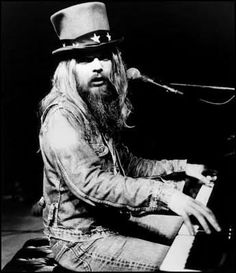 I'm up on the tight wire One side's ice and one is fire It's a circus game With you and me  I'm up on the tight rope One side's hate and one is hope But the top hat on my head Is all you see.  Leon Russell - Tightrope