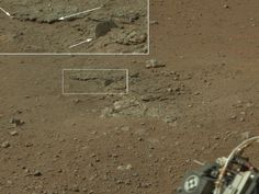 This color image from NASA's Curiosity rover shows an area excavated by the blast of the Mars Science Laboratory's descent stage rocket engines.