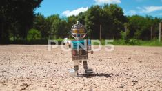 Robot Toy walking down the street - Stock Footage   by Poberailo
