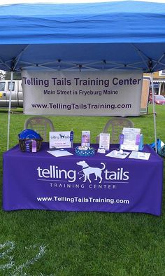 "Telling Tails shares their product story: ""We are ""howling"" happy to have our table cover for events. It looks so professional and really stands out with our logo! We had many compliments on our display at the recent Bark in the Park event. Thank you Totally Table Covers - high paw for this one!!!!!"""