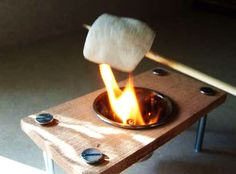 """If you've always wanted to make S'mores at home (or just roast a marshmallow for that yummy fresh-from-the-campfire taste), then here's a """"fire pit"""" you're sure to dig. This homemade mini firepit isn't much bigger than a marshmallow itself, but. Indoor Grill, Indoor Smores, Thinking Day, Mini S, A Table, Grilling, Picnic, Diy Projects, Welding Projects"""