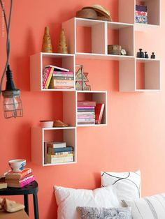 Mismatched wall boxes to use as shelving/decoration for: books, movies, pictures, candles, etc.